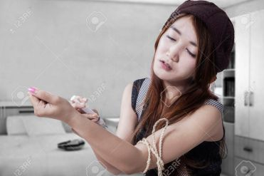 Drug addict teenage girl with syringe